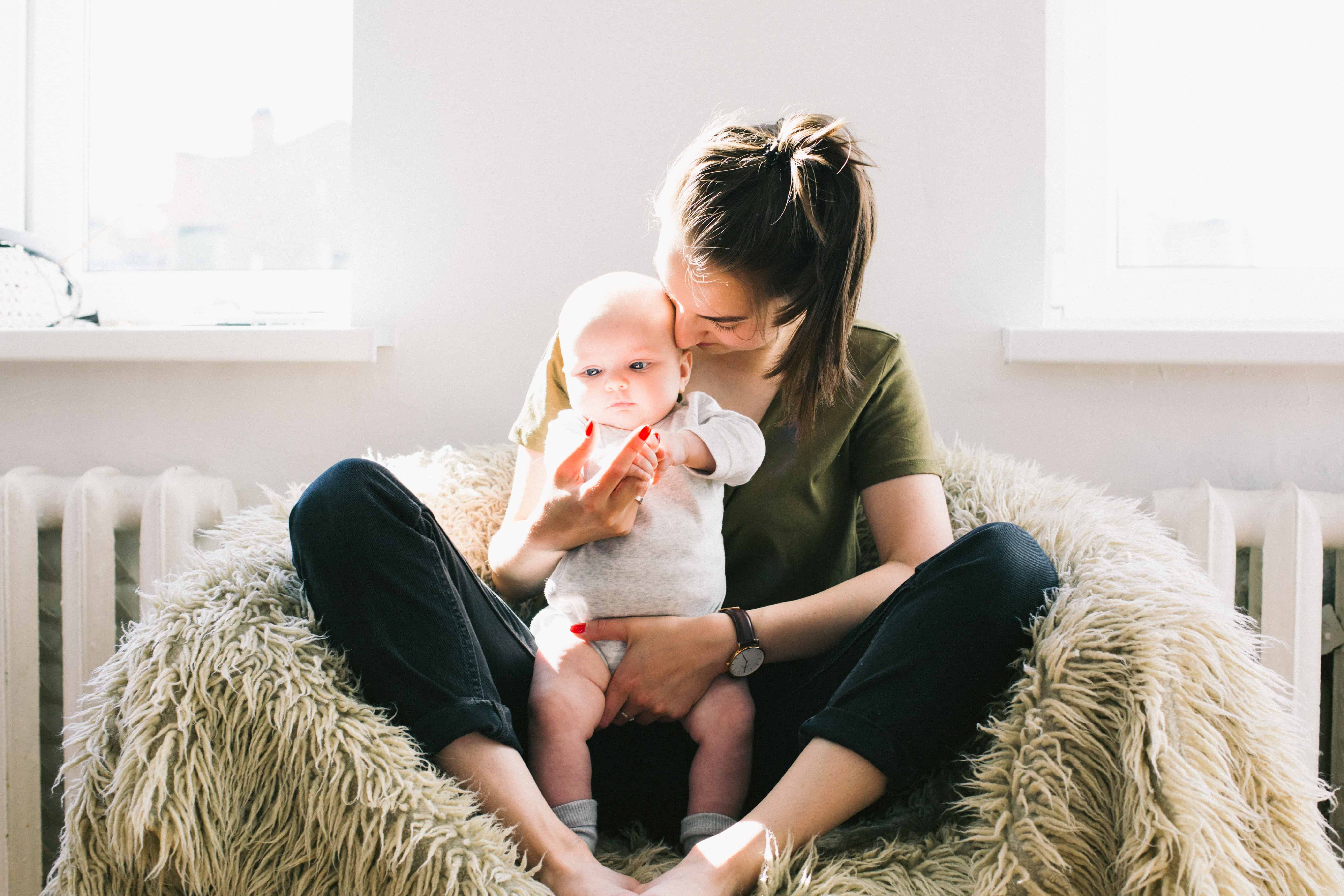 toddler and newborn schedule: playing with baby